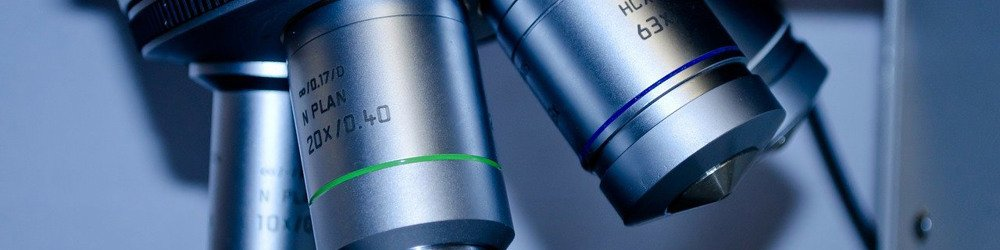 microscope close up, metal tool used to magnify small cultures and other scientific evidence