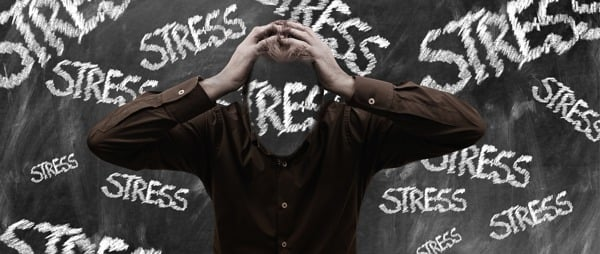 The word stress written repeatedly on a blackboard